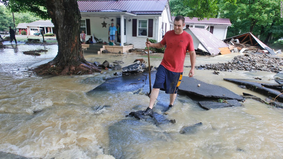 Mark Bowes makes his way to a road after severe flooding in White Sulphur Springs on June 24.