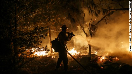 A firefighter controls the fire before it reaches the residential homes in Lake Isabella, California on June 23.