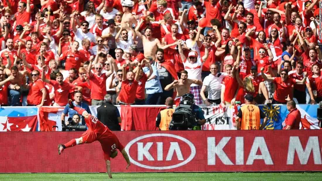 Switzerland midfielder Xherdan Shaqiri celebrates after scoring his team's stunning equalizer.