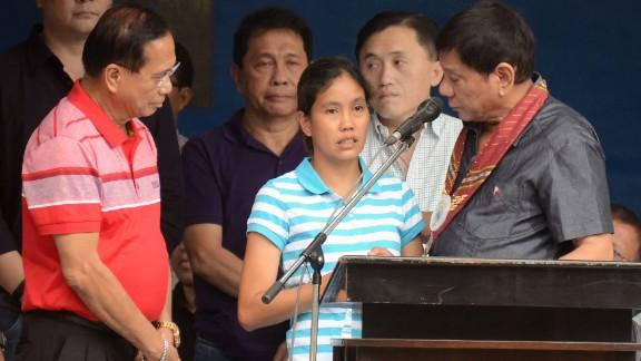 Duterte talks to released hostage Marites Flor on stage, June 24, 2016.