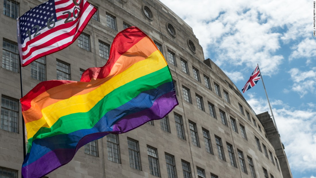 An American flag with the date of the Orlando shootings flies above a rainbow flag with a Union Jack in the distance during London's Pride march on June 25.