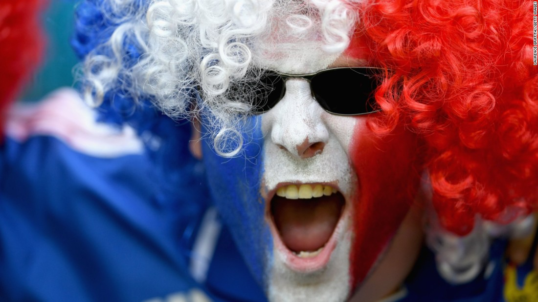A France fan cheers his team.