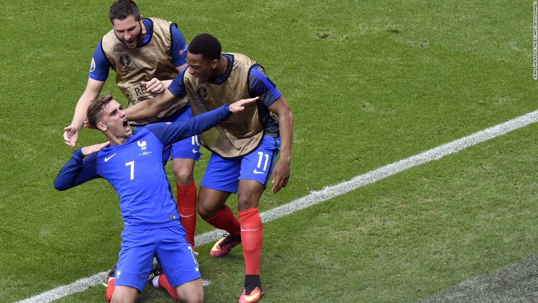 France's Antoine Griezmann and teammates celebrate scoring a goal.