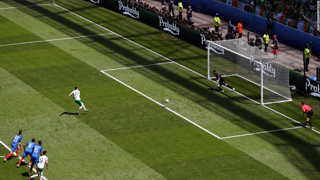 Robbie Brady of Ireland converts a penalty to score the opening goal past Hugo Lloris of France.