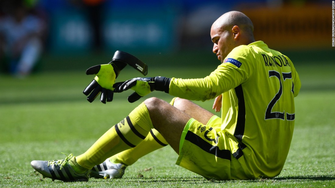 Ireland's goalkeeper Darren Randolph throws away his glove after the game.