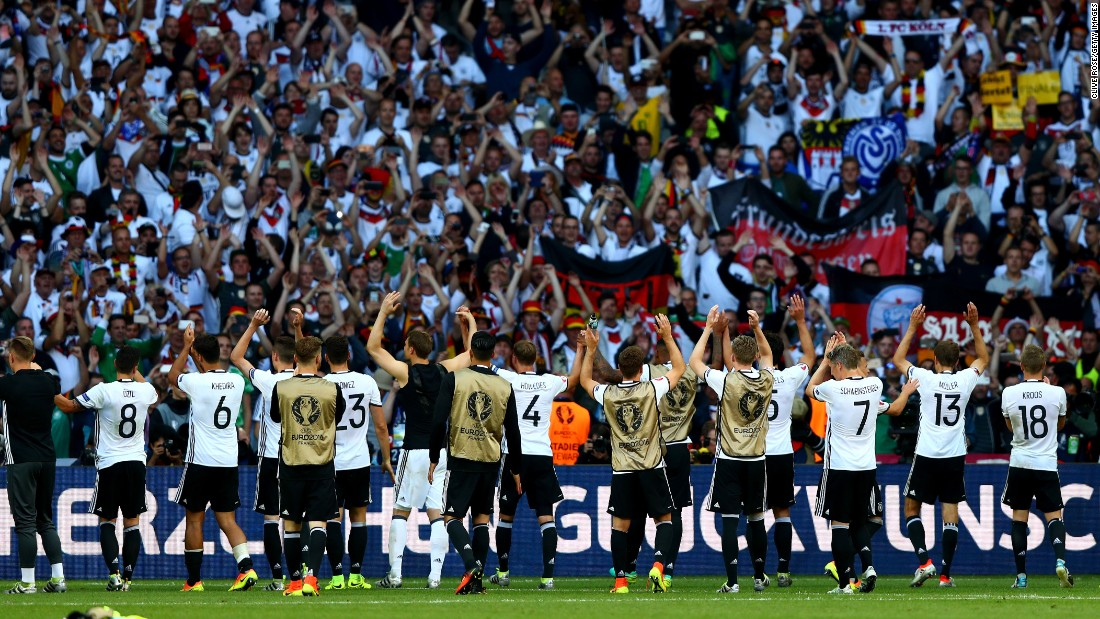 Germany players applaud their supporters after their 3-0 win over Slovakia at Stade Pierre-Mauroy on Sunday in Lille, France.