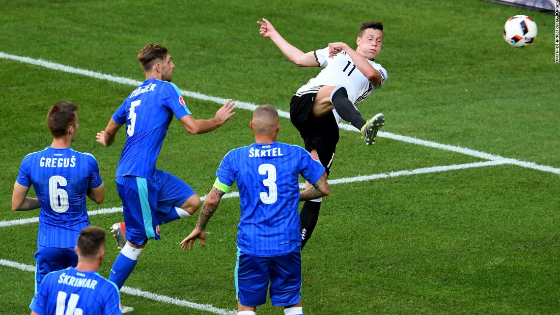 Julian Draxler, right, of Germany scores his team's third goal.