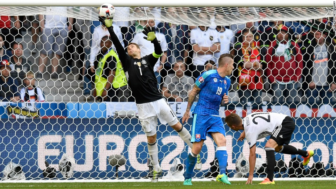 Goalkeeper Manuel Neuer of Germany tips the ball over the bar after a shot by Juraj Kucka of Slovakia.