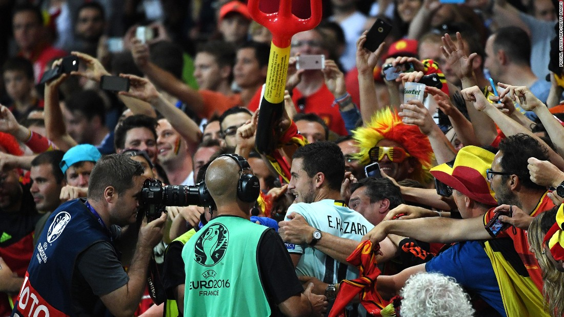 Belgian forward Eden Hazard, center, celebrates with supporters after Belgium's 4-0 victory over Hungary, at the Stadium Municipal in Toulouse, France on Sunday, June 26.