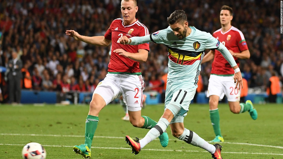 Belgium's forward Yannick Ferreira-Carrascoa, right, shoots and scores his team's fourth goal.
