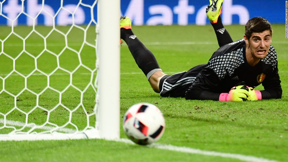 Belgian goalkeeper Thibaut Courtois reacts as he dives for the ball.