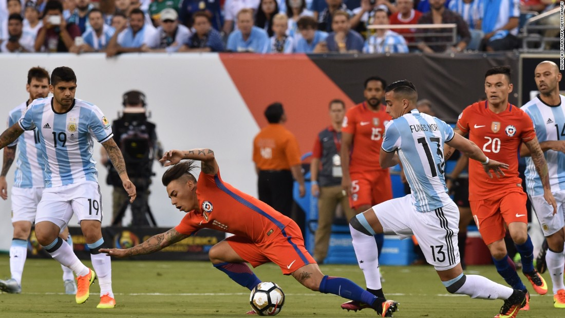 Chile's Eduardo Vargas is fouled by Argentina's Ramiro Funes Mori.