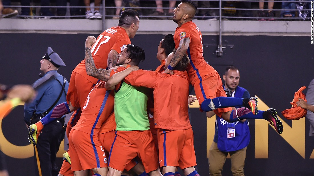 Chile's players celebrate after defeating Argentina in the penalty shoot-out and winning the Copa America Centenario final in East Rutherford, New Jersey, on Sunday, June 26.