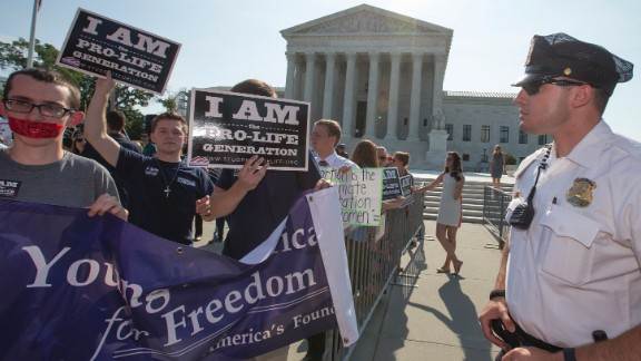 Activists demonstrate in front of the Supreme Court in Washington, Monday, June 27, 2016, as the justices close out the term with decisions on abortion, guns, and public corruption are expected.