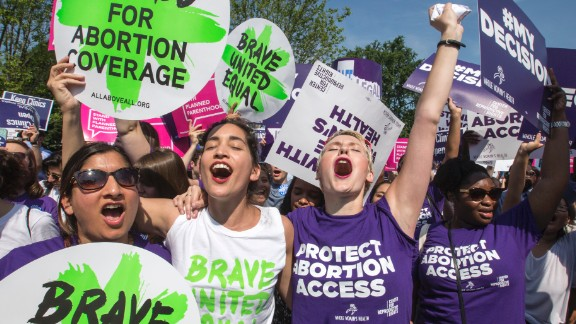 Abortion rights activists, from left, Ravina Daphtary of Philadelphia, Morgan Hopkins of Boston, and Alison Turkos of New York City, rejoice in front of the Supreme Court in Washington, Monday, June 27, 2016, as the justices struck down the strict Texas anti-abortion restriction law known as HB2. Other cases are to follow on guns, and public corruption.
