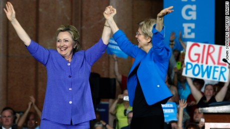 Hillary Clinton and U.S. Sen Elizabeth Warren wave to the crowd before a campaign rally on June 27, 2016 in Cincinnati, Ohio.