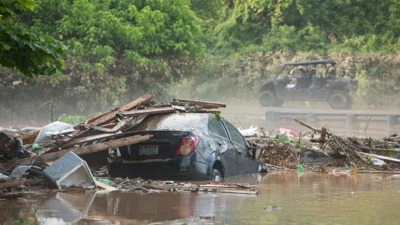 A car sits in floodwaters in Jordan Creek, West Virginia, on June 26.
