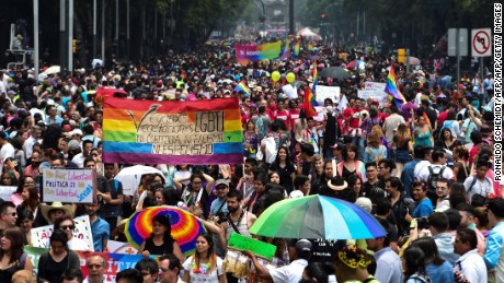 People take part in the Gay Pride Parade in Mexico City, on June 25, 2016.  Thousands of people took to the streets in the Mexican capital to participate in the parade. / AFP / RONALDO SCHEMIDT        (Photo credit should read RONALDO SCHEMIDT/AFP/Getty Images)