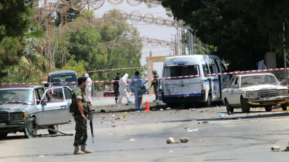 Lebanese security forces secure the site of the suicide attacks.
