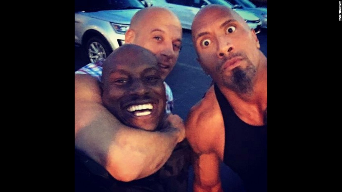 "Vin Diesel puts Tyrese Gibson in a headlock as they take a selfie with fellow actor Dwayne Johnson on Wednesday, June 22. They were filming the eighth installment of the ""Fast and Furious"" film franchise. ""We and the entire Fast 8 team... Will make you proud,"" <a href=""https://www.instagram.com/p/BG-MHovmPsQ/"" target=""_blank"">Diesel said on Instagram. </a>"