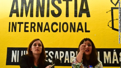 "Erika Guevara-Rosas (R), director for the Americas of Amnesty International speaks next to Madeleine Penman researcher on Mexico for Amnesty International (L) during the presentation of the report  ""Survive to the death"" on torture to women in jails of Mexico, on June 28, 2016, in Mexico city. / AFP / RONALDO SCHEMIDT        (Photo credit should read RONALDO SCHEMIDT/AFP/Getty Images)"
