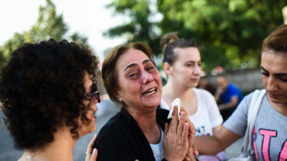 A woman cries in Istanbul on June 29.