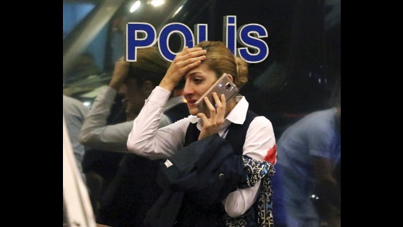 A wounded woman talks on the phone following the attack.