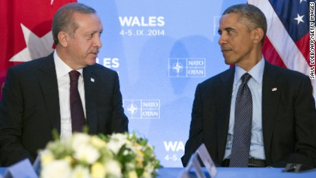 US President Barack Obama (R) and Turkey's Prime Minister Recep Tayyip Erdogan (L) talk at a bilateral meeting on the second day of the NATO 2014 Summit at the Celtic Manor Resort in Newport, South Wales, on September 5, 2014.
