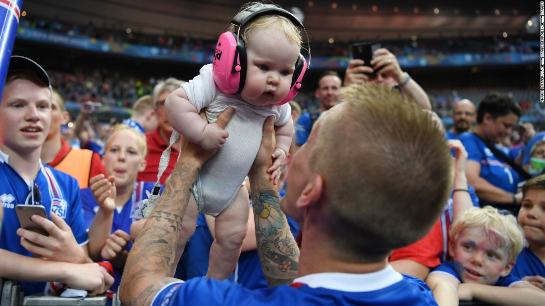 Ari Skulason of Iceland celebrated with his baby while his teammates sought out family members inside the stadium. Around 8% of the country's population is estimated to have traveled to France for the finals.