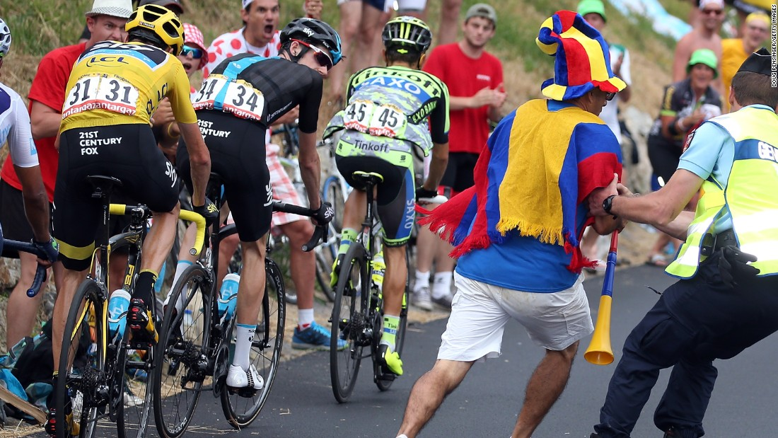 Over enthusiastic fans can pose a risk to riders and here a Colombian supporter is pulled aside by a gendarme during the 2015 race won by Froome.