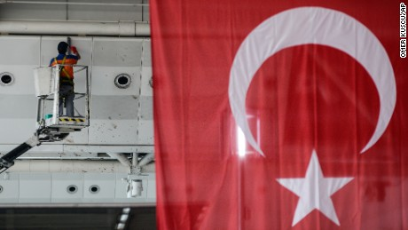A worker wipes traces of blood and debris from the wall of Ataturk Airport in Istanbul on June 29. Suicide bombers armed with guns killed dozens and wounded more than 140 on June 28, the latest in a series of bombings to strike Turkey in recent months. Turkish officials said the massacre was most likely the work of the Islamic State group.