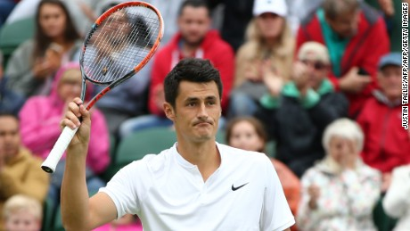 Tomic celebrates after beating Spain's Fernando Verdasco at Wimbledon in 2016.