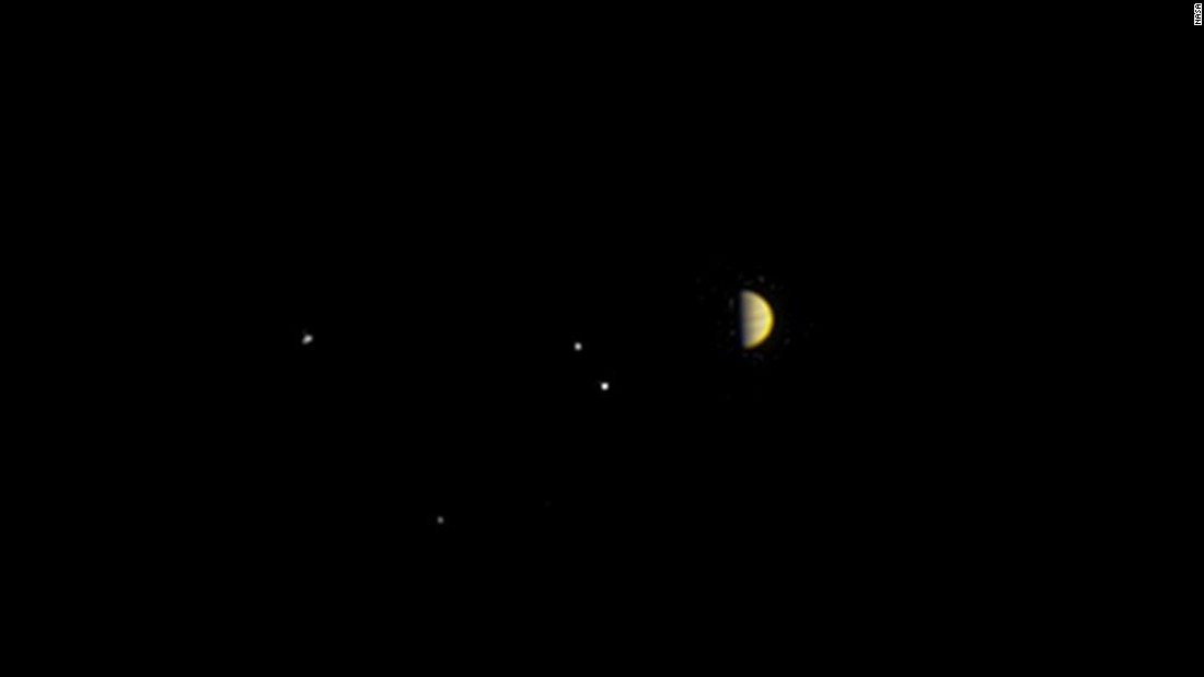 Jupiter and the gaseous planet's four largest moons -- Io, Europa, Ganymede and Callisto -- are seen in a photo taken by Juno on June 21, 2016. The spacecraft was 6.8 million miles (10.9 million kilometers) from the planet.