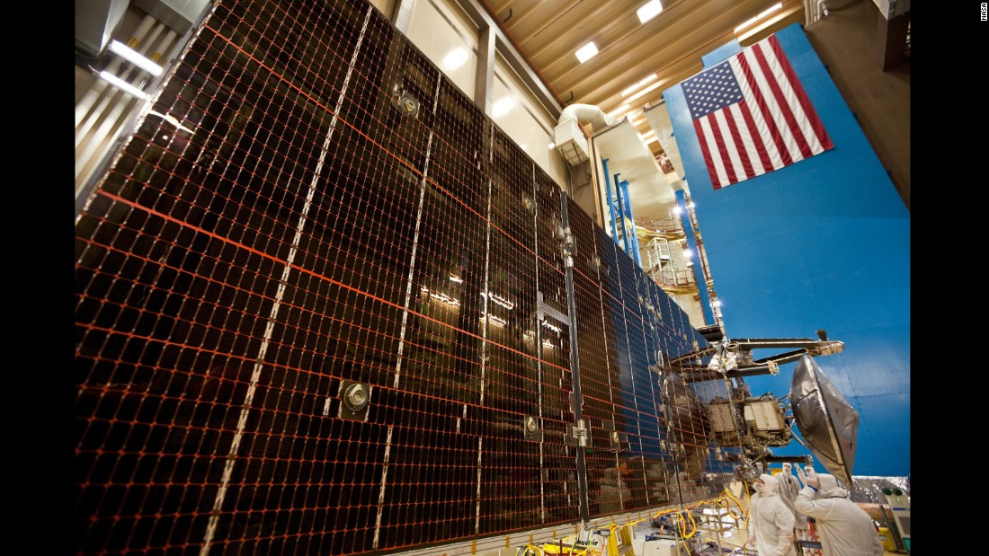Technicians test the three massive solar arrays that power the Juno spacecraft. In this photo taken February 2, 2011, each solar array is unfurled at a Lockheed Martin Space Systems facility in Denver.
