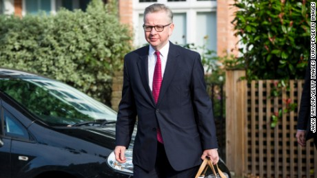 British Justice Secretary Michael Gove leaves his home in London ahead of announcing his leadership bid.