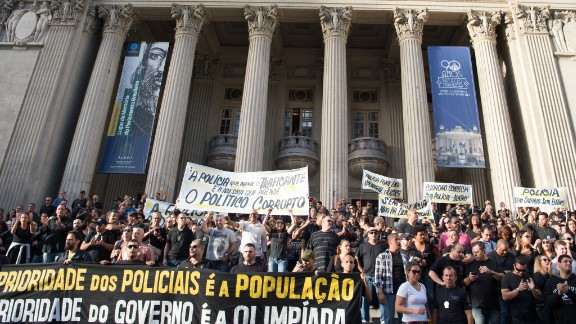 Police demonstrate against the government for arrears in their salary payments on June 27, 2016 in Rio de Janeiro, Brazil.