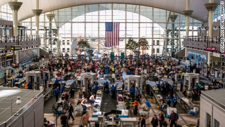 The TSA security lines crowded with vacation travelers in Denver, Colorado.