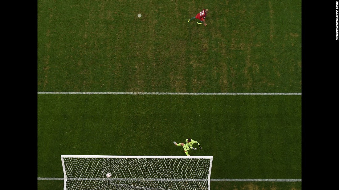 Portugal's Ricardo Quaresma, top, reacts after scoring the penalty that clinched the victory.