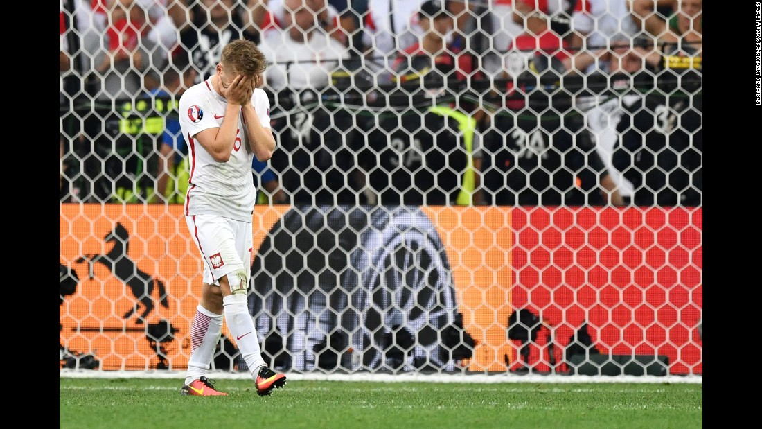 Poland's Jakub Blaszczykowski covers his face after his penalty was saved by Rui Patricio. It was the only miss of the shootout, which ended 5-3.