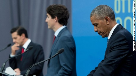 (L-R) Mexican President Enrique Pena Nieto, Canadian Prime Minister Justin Trudeau and US President Barack Obama listen during a press conference at the North American Leaders Summit at the National Gallery of Canada June 29, 2016 in Ottawa, Ontario. / AFP / Brendan Smialowski        (Photo credit should read BRENDAN SMIALOWSKI/AFP/Getty Images)