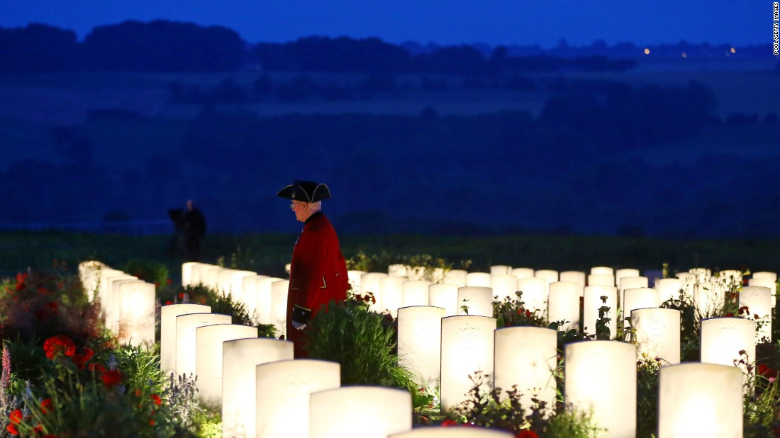 At dusk a man is seen among the military graves at the Thiepval Memorial.