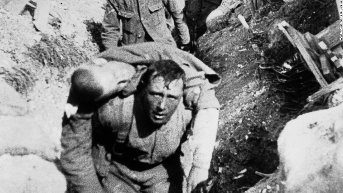 "A still from the film, ""The Battle of the Somme,"" shows a British soldier carrying a wounded comrade back from the front line. The scene is generally accepted as having been filmed on the first day of the battle on July 1, 1916. The film and film stills are part of the Imperial War Museum's collections, and the film is featured in IWM London's new exhibition, ""Real to Reel: A Century of War Movies."""