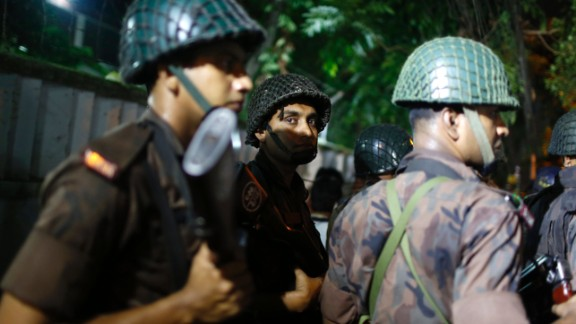 Bangladeshi security personnel stand guard near a restaurant that has reportedly been attacked by unidentified gunmen in Dhaka, Bangladesh, Friday, July 1, 2016. Local media reported that a group of attackers took hostages inside a restaurant frequented by both locals and foreigners in a diplomatic zone in Bangladesh