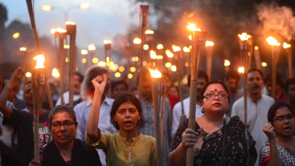 Bangladeshi secular activists take part in a torch-lit protest against the killing of blogger Niloy Chakrabarti, who used the pen-name Niloy Neel, in Dhaka on August 8, 2015.  Dhaka vowed August 8 to hunt down the killers of secular blogger Niloy Chakrabarti who became the fourth such writer to be murdered in Bangladesh by suspected Islamist militants this year. AFP PHOTO/ Munir uz ZAMAN        (Photo credit should read MUNIR UZ ZAMAN/AFP/Getty Images)