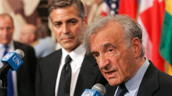 Nobel Peace Prize laureate Elie Wiesel, right, and actor George Clooney respond to questions after addressing the Security Council at the United Nations in New York on September 14, 2006. Wiesel died July 2, 2016, at age 87.