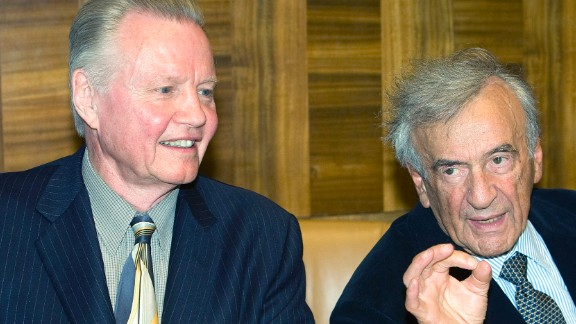 """Nobel laureate Elie Wiesel, right, and actor Jon Voight, left, wait for the beginning of a conference on """"Lessons of the Holocaust for Antisemitism and Intolerance in the 21st Century"""" at the United Nations office in Geneva, Switzerland, in 2009."""
