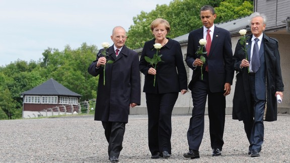 Buchenwald survivors Elie Wiesel, right, and Bertrand Hertz, left, walk with German Chancellor Angela Merkel and U.S. President Barack Obama at the Buchenwald camp near Weimar, Germany, on  June 5, 2009. Wiesel, 87, died on July 2, 2016.