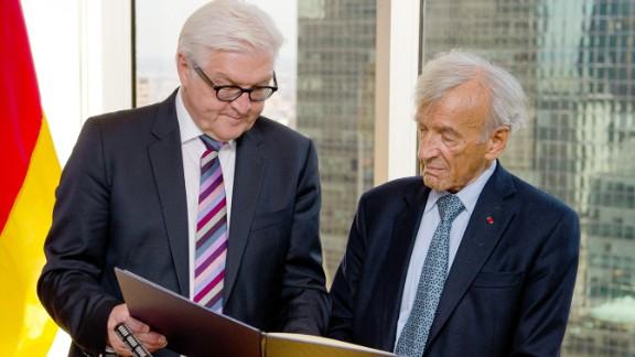 German Foreign Minister Frank-Walter Steinmeier, left, presents Elie Wiesel the German Federal Cross of Merit in New York on September 23, 2014.