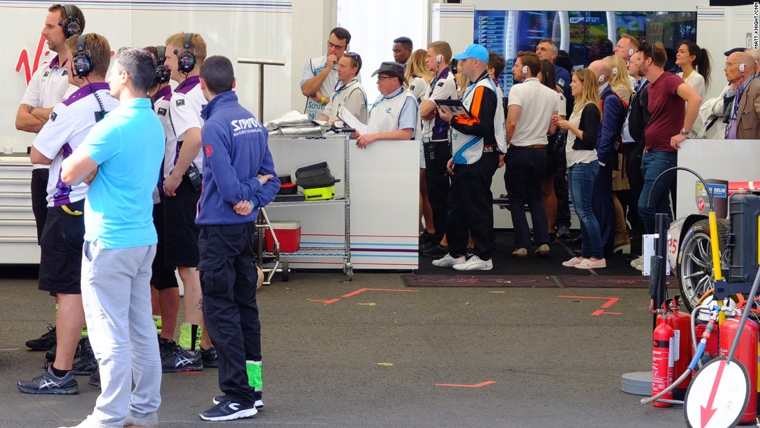 The DS Virgin Racing team watch the action unfold on TV screens in the pit garage.