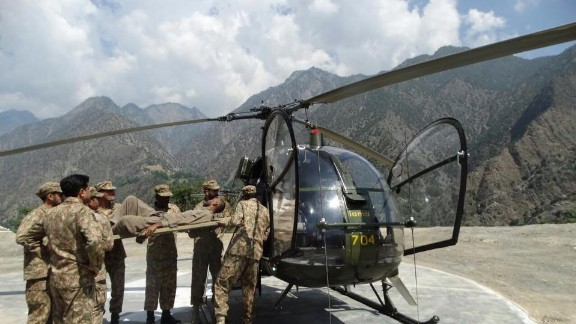 The Pakistan Army rescues flood victims by helicopter  in the Chitral region.